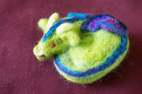 Needle felted sleeping dragon