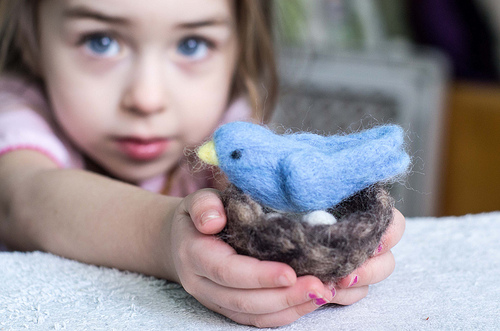 Willa holding the little blue bird