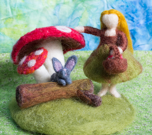 Woodland scene.. Girl picking mushrooms